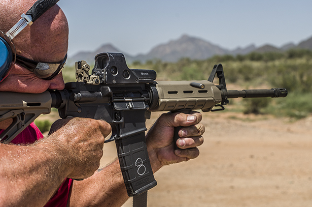 A man fires an AR-15 with laquer coated casings.
