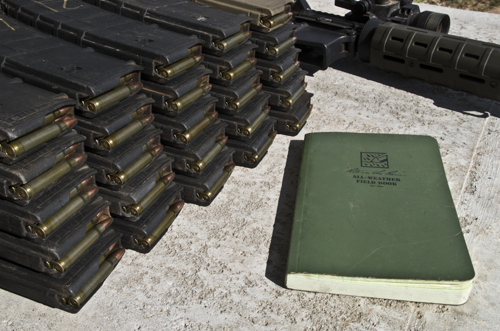 Log books and ammo magazines showing how the brass versus steel test was conducted.