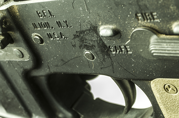 A close shot of an AR-15 rifle's trigger.